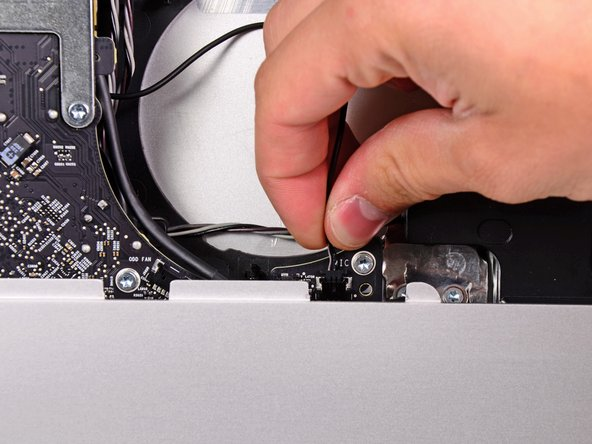 Pull the microphone cable connector toward the top edge of the iMac to disconnect it from the logic board.