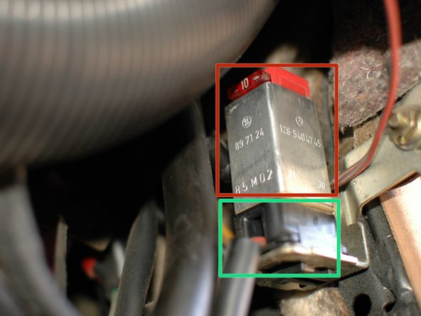 Image 1/1: Even if you are just checking the fuse, the easiest way to get access is to remove the entire relay. Simply pull it up and off of the black plug it is attached to, which sits beneath it.