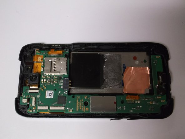 Carefully pry to loosen all 4 corners of the motherboard to remove.