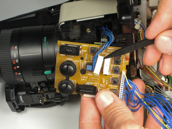 Use a spudger to help push the mini-circuit board away from the camcorder at the same time.