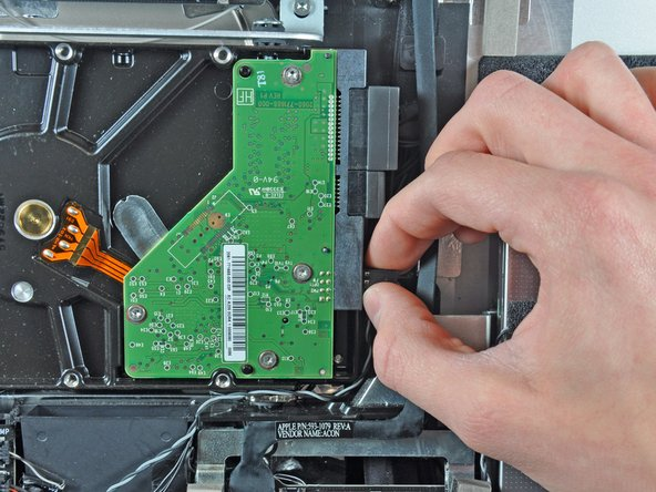 Image 1/1: Disconnect the thermal sensor by pulling its connector away from the side of the hard drive.
