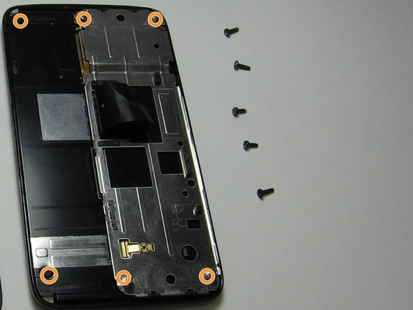 Image 1/1: You will need to take the screw driver and unscrew all six screws in the back of the touchscreen.