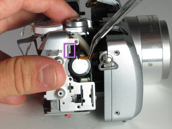 Remove the small ribbon cable, from the right side of the casing