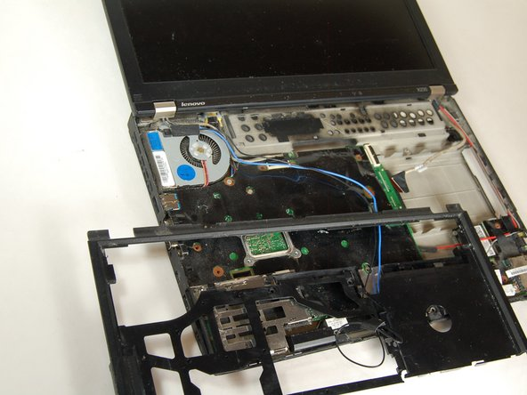 Carefully pull off black frame from laptop board.