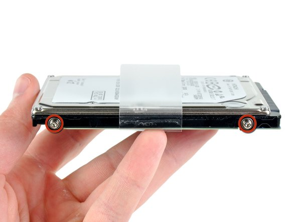 Transfer the hard drive retaining posts to your new hard drive.