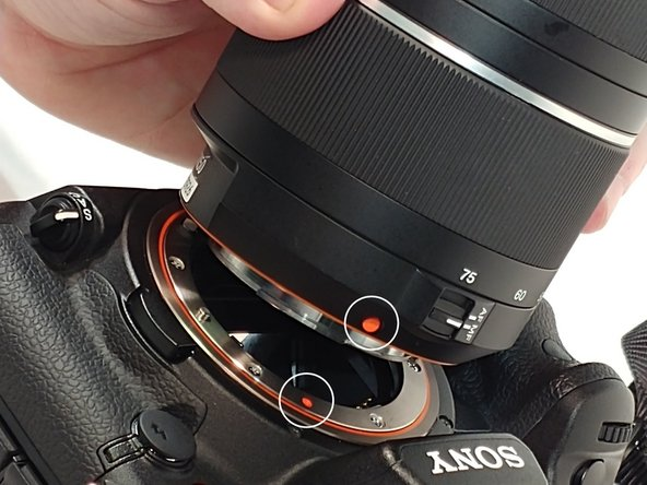 When re-installing the lens line up the orange dots that are one both lens and camera.