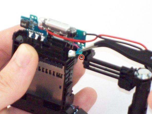 Image 1/2: Thread the indicator bulb under and through the secondary boards position.