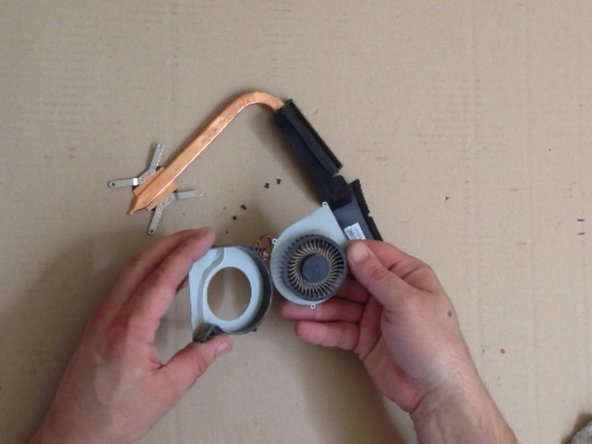 Image 3/3: Clean the radiator and the fan. Use a soft brush.