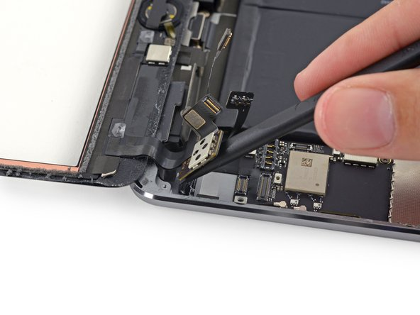 Lift the digitizer board up to free the last of the adhesive.
