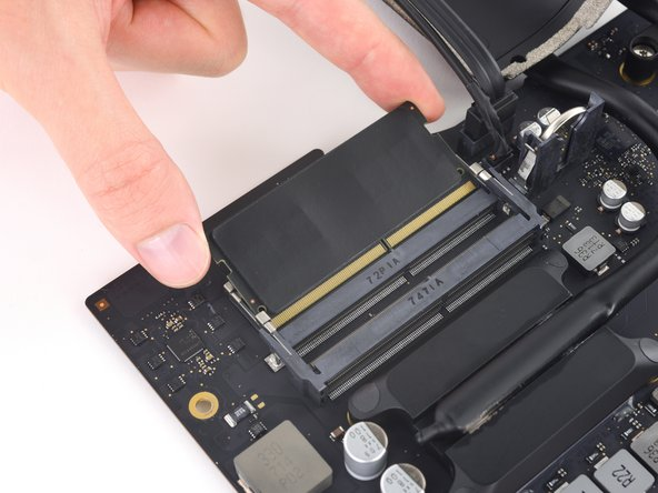 Image 1/2: Peel off and transfer the thermal pad from the original RAM stick to your replacement RAM before you install it in the lower slot.