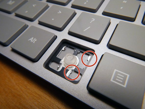 Image 3/3: The key tabs that hold the key to the base of the keyboard were sheared off, making repair of that beloved windows key pretty much impossible.