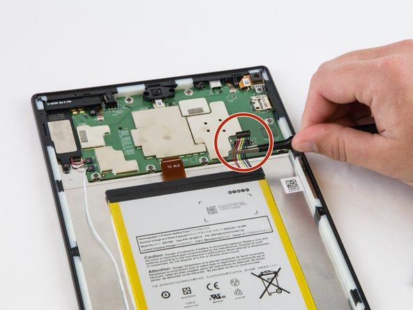 Carefully unplug the battery power cable to disconnect the battery from the motherboard.