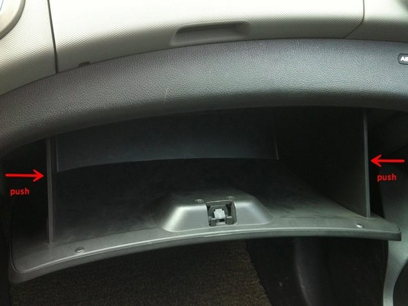open the glove box and push it from both left and right side to unsnatch it.