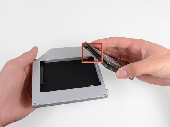 Image 1/3: Gently place the hard drive into the enclosure's hard drive slot.