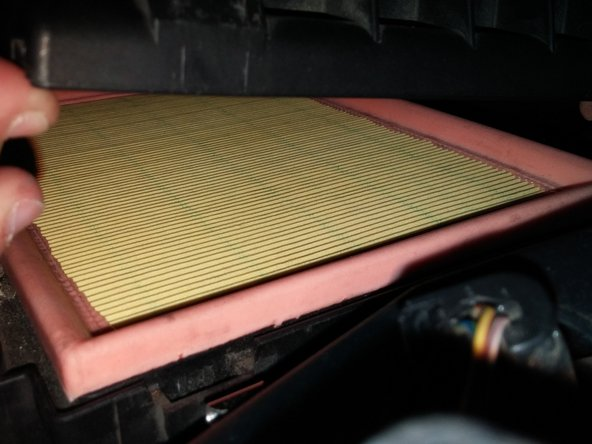 The new air filter might be slightly different from the one removed, as some filters have cotton pads on the bottom while some do not. Both styles of air filter are acceptable.
