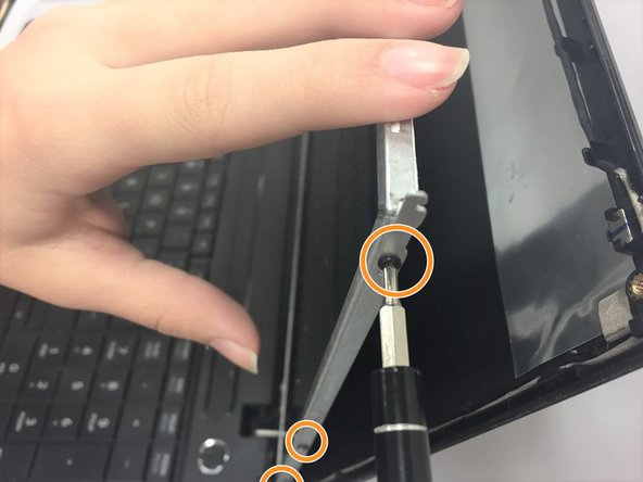 Using the same Phillips #1 screwdriver, remove the three screws on the side of screen frame.