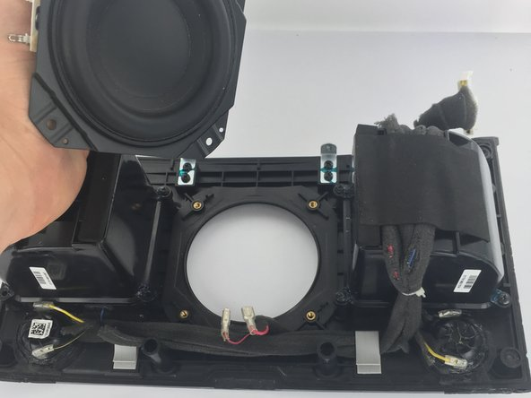 The subwoofer is now detached and able to be removed.
