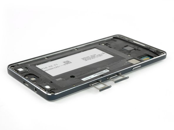 Remove the SD card tray and the SIM card tray.