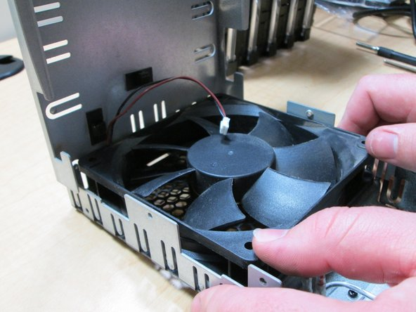 Now replace the fan.  Be careful to put it in the same way that it was taken out.  Then re-clasp on the wire.