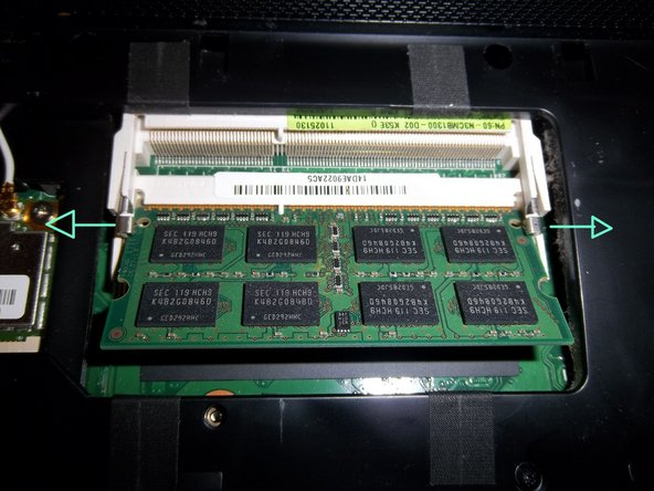 Remove the RAM module(s) by displacing both metal tabs outwards.