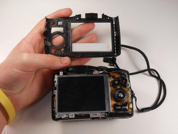 Remove the plastic panel surrounding the back screen.