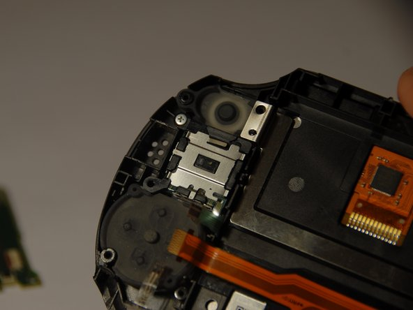 After the green casing  has been taken  off you should be able to see the back of the D-pad.