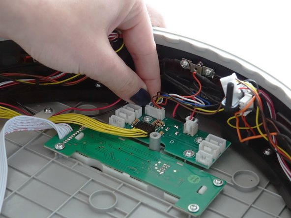 In the middle of bObi Pet's bumper is a circuit plug for one of the 5 wall sensors. Plug this one in at the topmost spot.