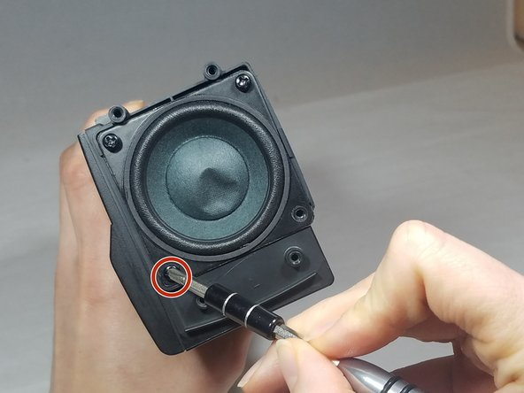 Remove the 4, PH1, 10 mm screws from the subwoofer frame.