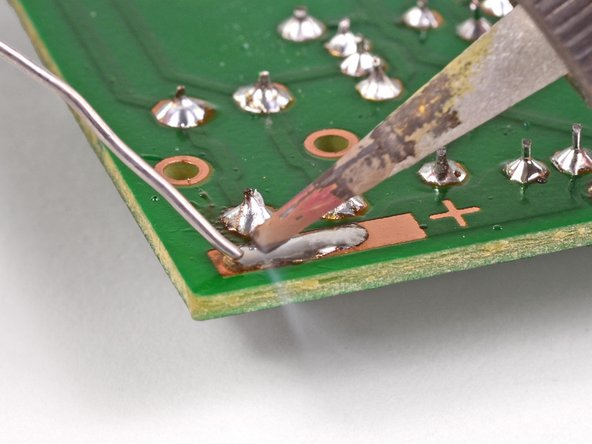 Repeat this process for the positive solder pad.