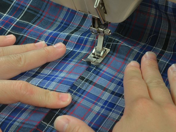 Some clothes have two rows of stitching, If your garment does, reposition it in the sewing machine. Drop the needle into the second line of stitches at about where you began sewing your previous seam.