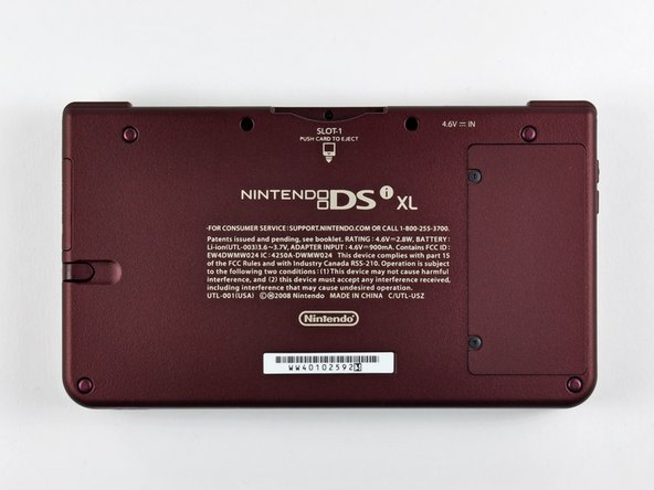 Image 3/3: The back side of the DSi XL. What a surprise! It's made in China.