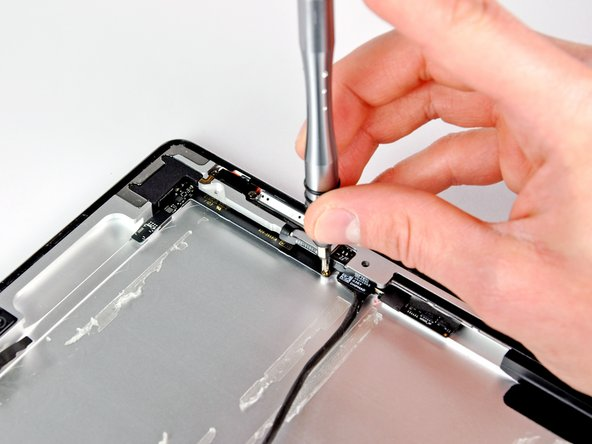 Image 1/1: Removing a screw that secures the volume control board to the case.