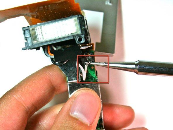 Image 2/2: Desolder the white wire.