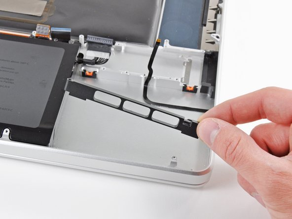 Remove the front hard drive bracket.