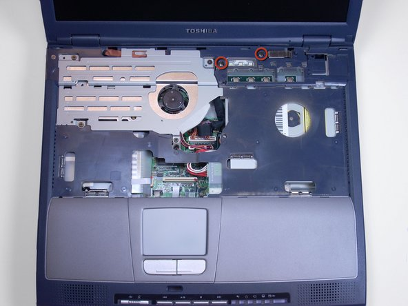 Using a Phillips screwdriver, unscrew and remove two screws labeled B25 located closest to the screen.
