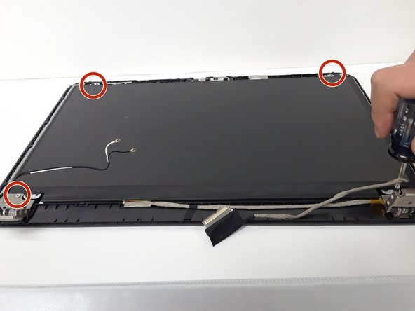 Remove the 4 M2 X 3mm Philips LCD screws.