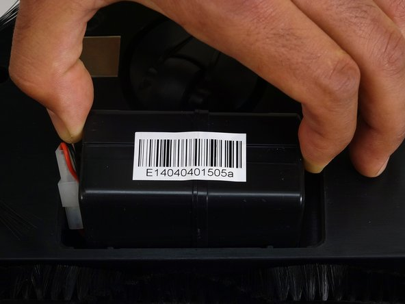 Image 3/3: Lower the battery down into bObsweep with the barcode facing up.