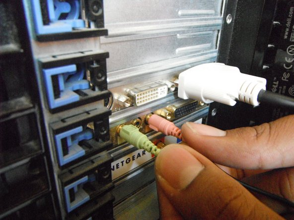"Before moving into the ""guts"" of the computer, unplug any wires that are connected to the audio ports on the back panel."