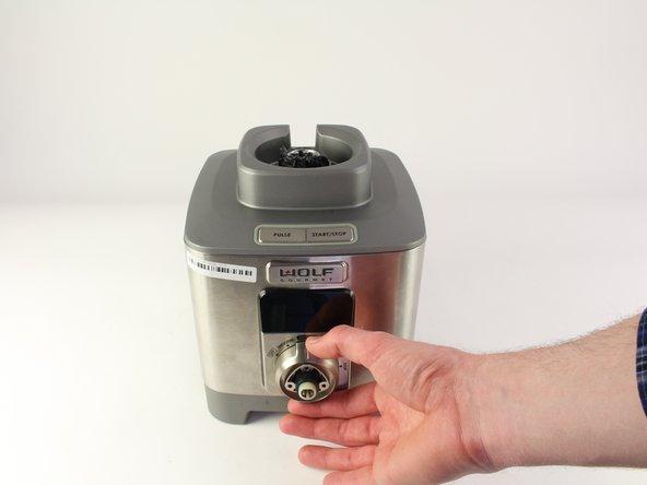 Pull the bezel from the base of the blender.