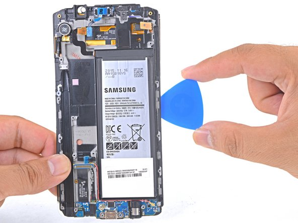 Stop when you get to the bottom of the battery to avoid damaging delicate capacitive buttons at the bottom of the display.