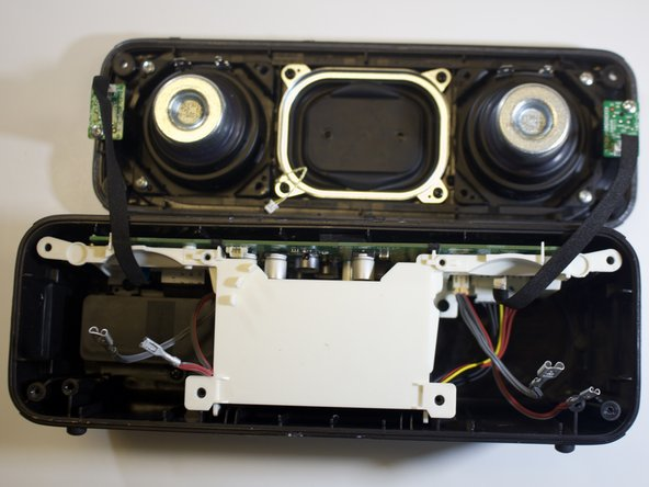 Separate the speaker lid from the bottom frame.