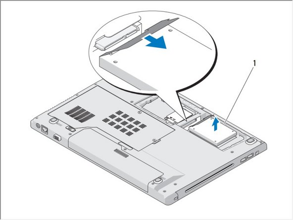 Remove the three screws securing the hard drive.