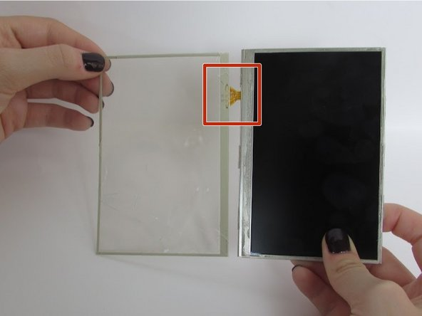 Image 2/2: Be careful not to rip or tear the film connecting the glass screen and the LCD screen.