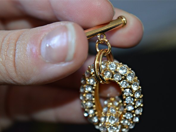 Test that the clasp and jump ring are properly attached by holding the bracelet from the clasp and suspending the rest of the bracelet.