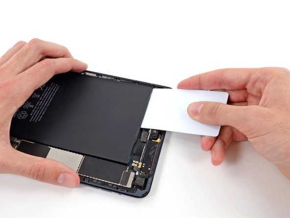 Throughout the following procedure, you'll be sliding thin plastic cards between the battery and rear case of the iPad, to separate the adhesive securing the battery in place. Be careful to keep the cards as flat as possible to avoid bending the battery, which may damage it and cause it to release dangerous chemicals.