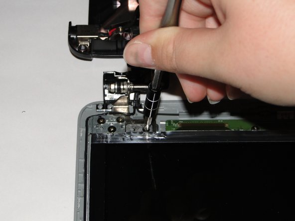 Remove the four black 3mm screws from the screen attachment points using a Phillips 1 screwdriver.