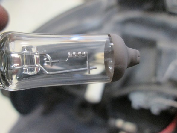 Image 3/3: If you're changing the bulbs in pairs, or otherwise removing a still-working bulb, keep that working bulb around. The Audi A4 has 4 to 6 of the exact same bulb (low beam, high beam, and potentially fog lights), so an extra is good to have the next time a light goes out.