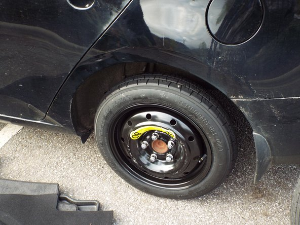 Tighten lug nuts (again, beginning with the 1, 3 and 5 positions) with lug wrench until secure.
