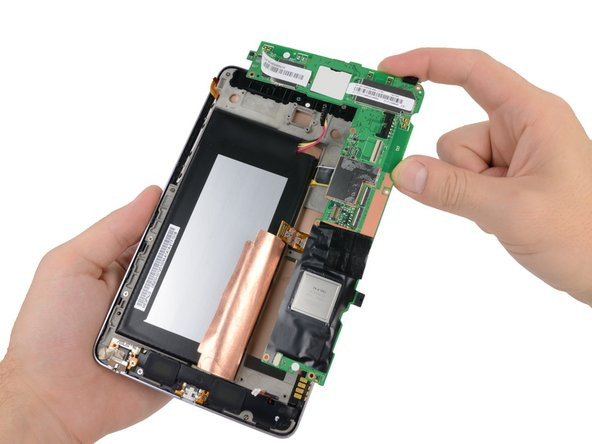 Carefully lift the motherboard assembly out of the Nexus 7, minding any cables that may get caught.