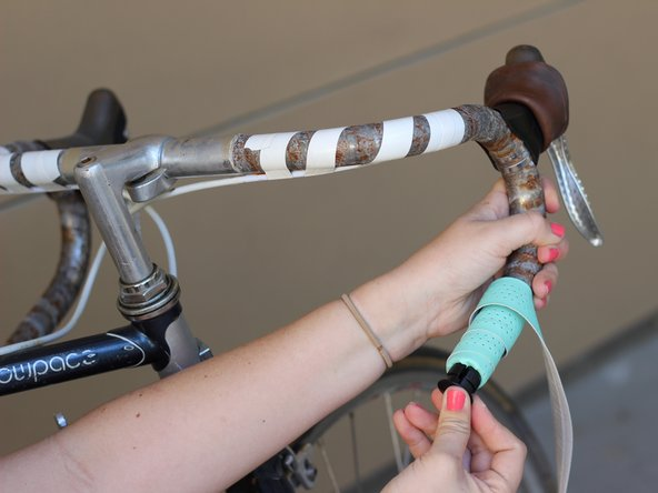 After a few wraps, tuck the extra bar tape into the end of the handlebar and firmly push in the bar end plug.